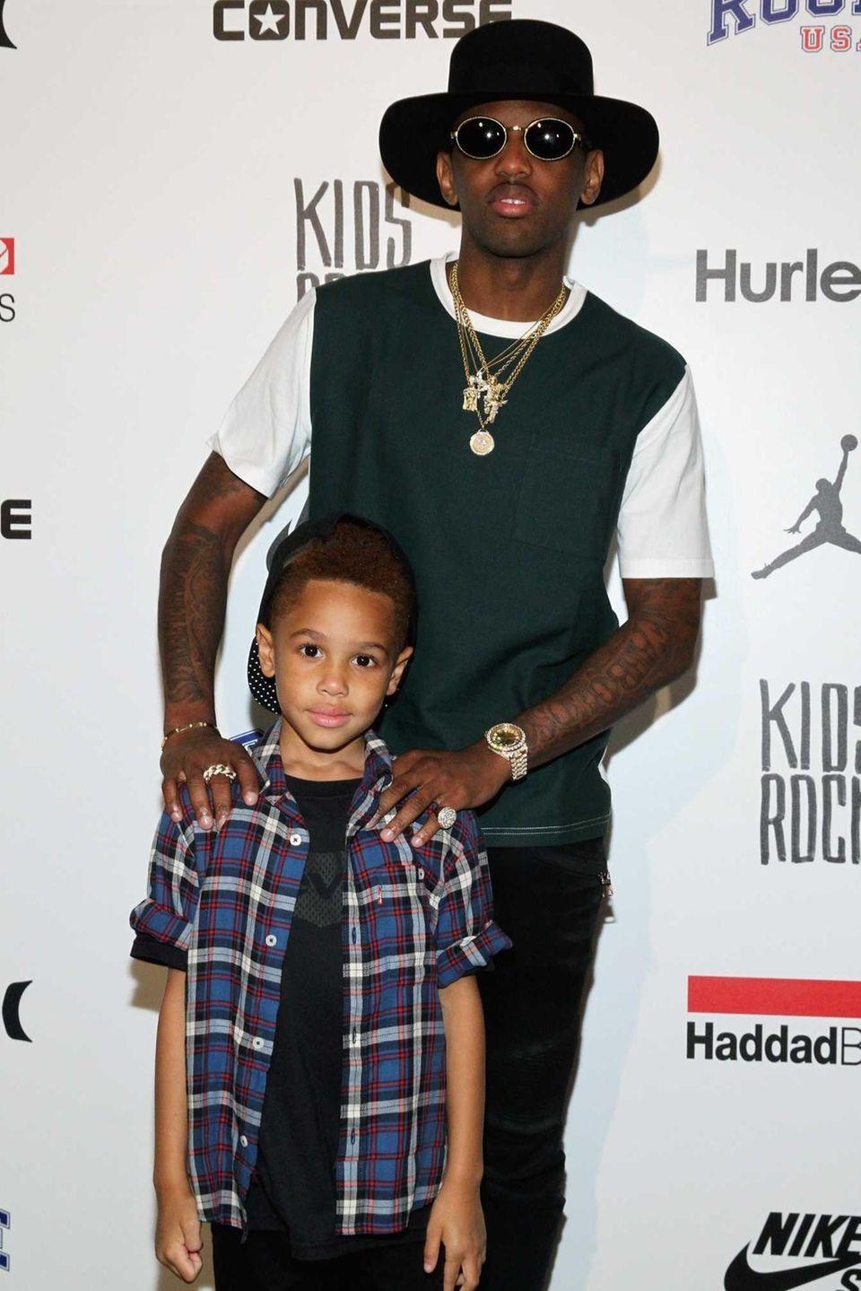 Rapper Fabolous and his son, Johan Jackson, pose