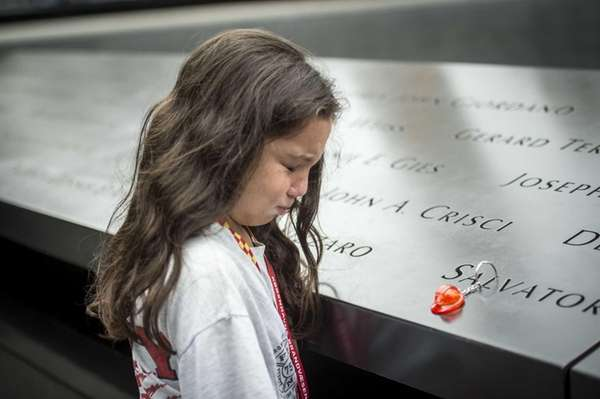 Eight-year-old Gianna Calabro weeps as she thinks about