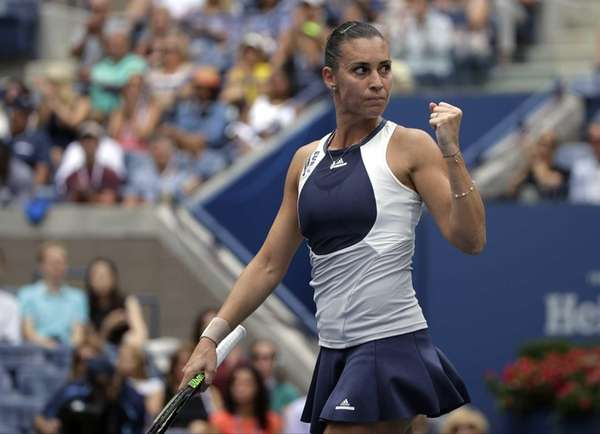 Flavia Pennetta, of Italy, reacts after winning a