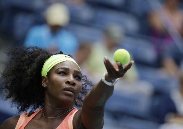 Serena Williams serves to Roberta Vinci, of Italy,