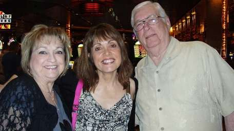Barbara Anne Kirshner of Miller Place, center, with