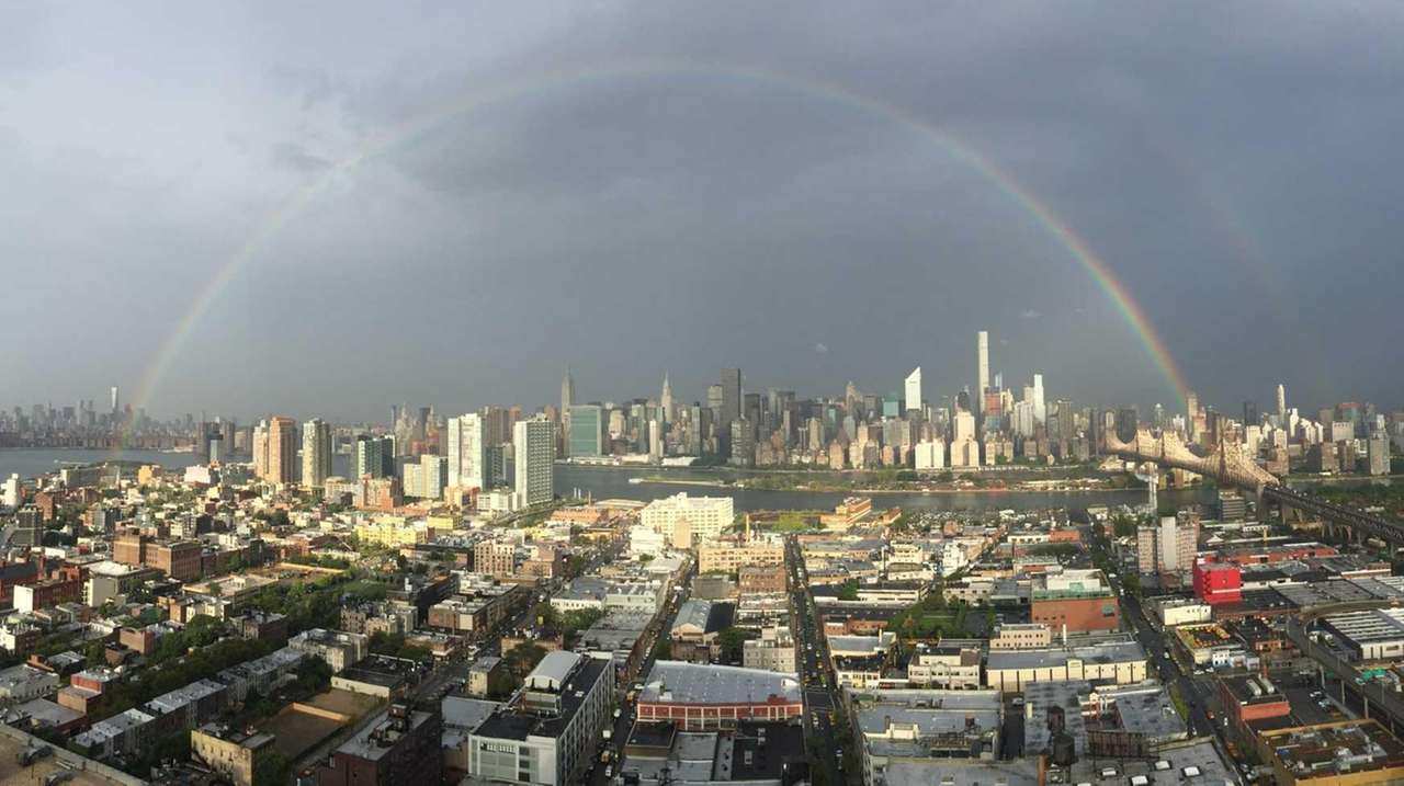 rainbow emerges near freedom tower on eve of 9 11. Black Bedroom Furniture Sets. Home Design Ideas