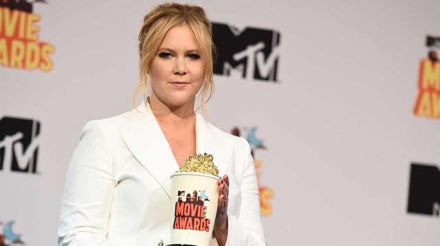 Amy Schumer in the press room at the