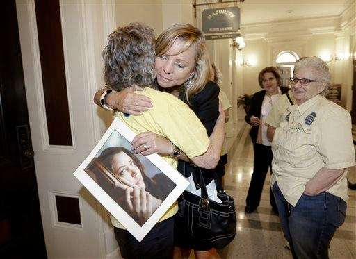 Debbie Ziegler holds a photo of her daughter,