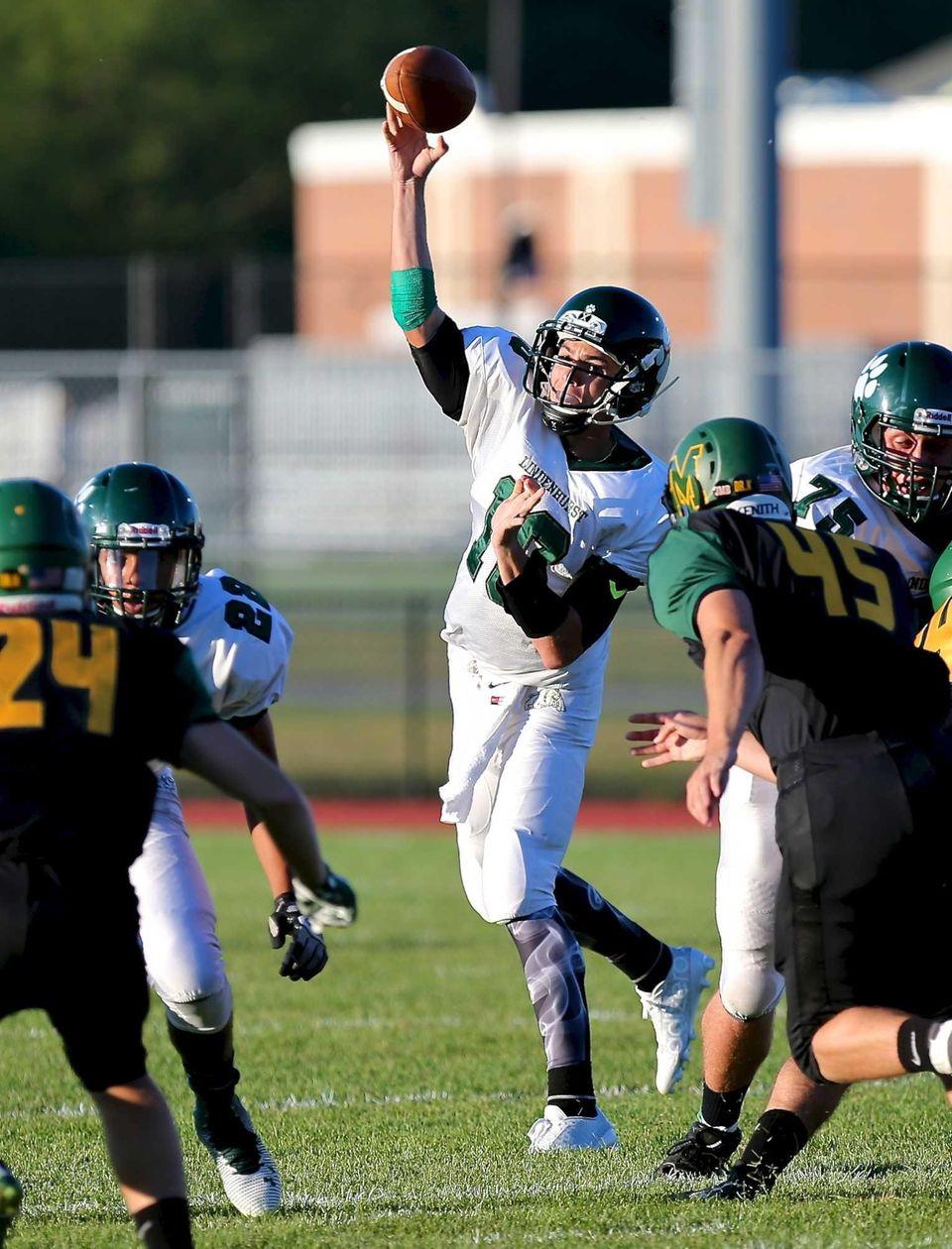 Lindenhurst QB Ryan Hofmann attempts a pass during