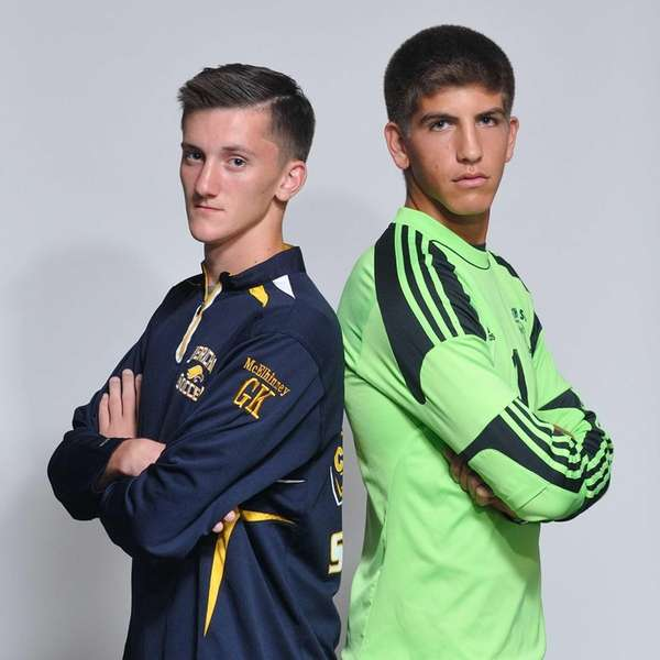 Goalkeepers Tyler McElinney of Jericho, left, and Josh