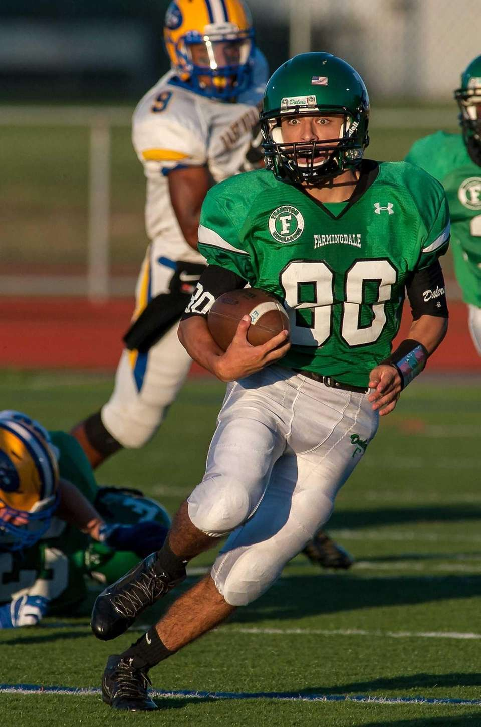 Farmindale's Frank Tocchia runs with the ball during