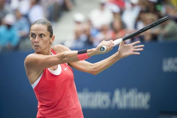 Roberta Vinci hits a backhand against Serena Williams