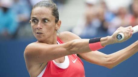 Roberta Vinci hits a backhand against Serena Williams
