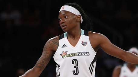 New York Liberty's Erica Wheeler reacts after missing