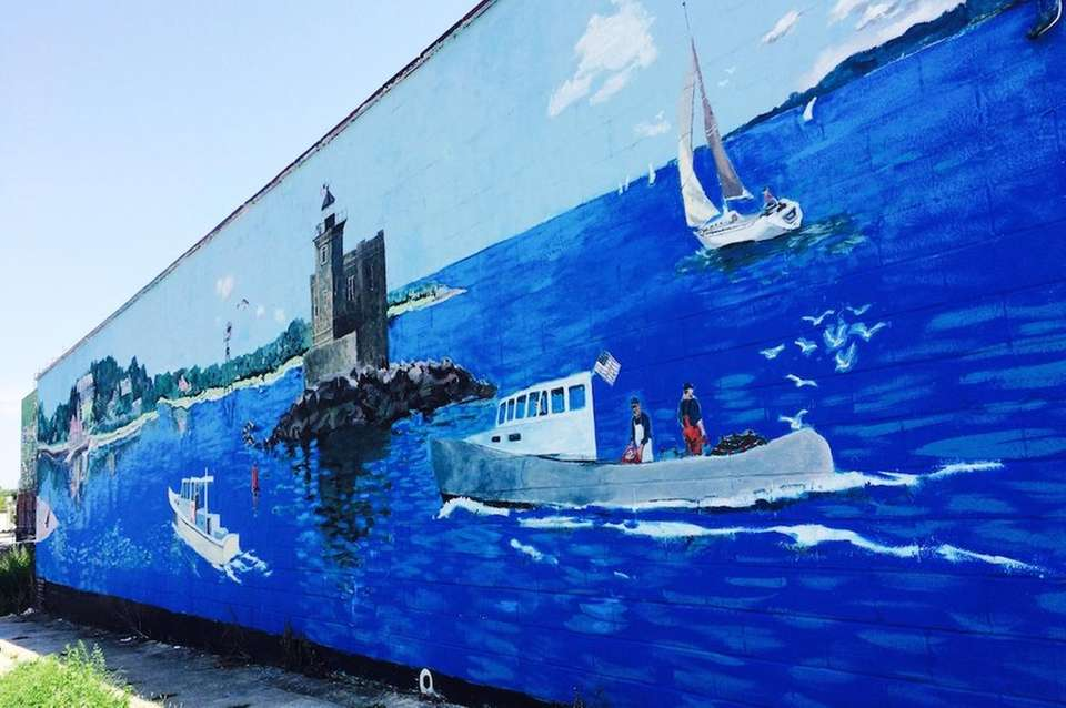 This large outdoor mural, a vivid landscape depicting