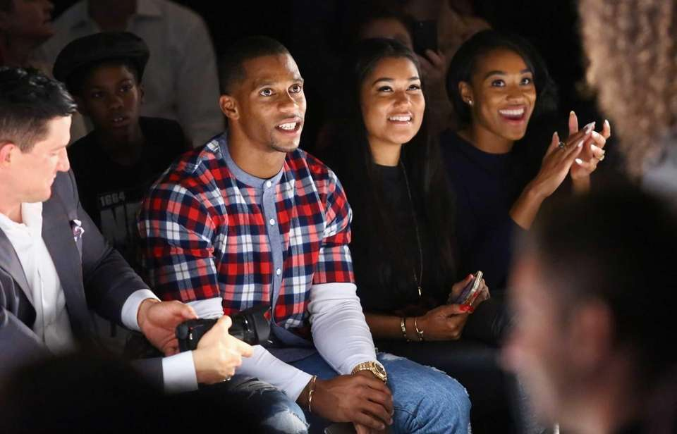Giants wide receiver Victor Cruz and his fiancee,