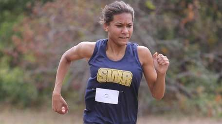 Katherine Lee of Shoreham-Wading River crosses the finish