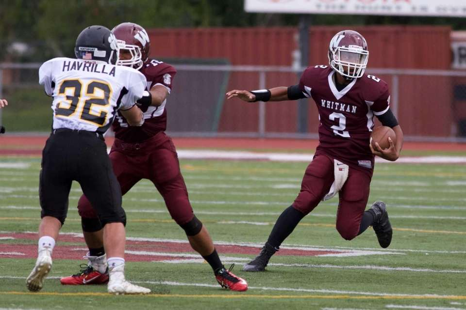 Walt Whitman's quarterback Isaiah Wilkerson (2) runs as