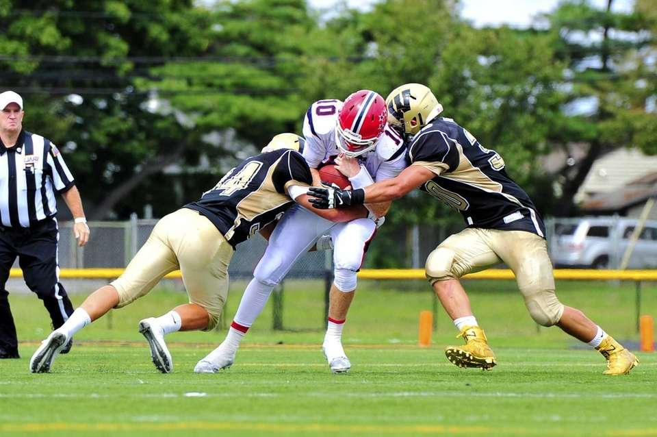 MacArthur quarterback Kimmy Kelleher (10) is taken down
