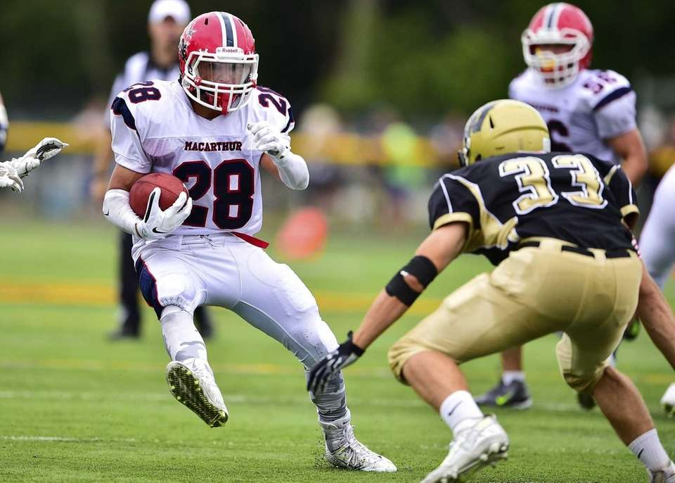MacArthur running back Vin Martino (28) runs the