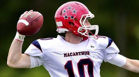 MacArthur quarterback Jimmy Kelleher (10) steps back to