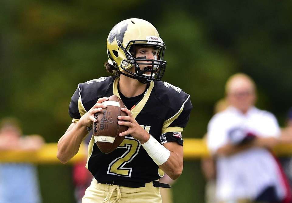 Wantagh quarterback Robert Tucker (2) steps back to