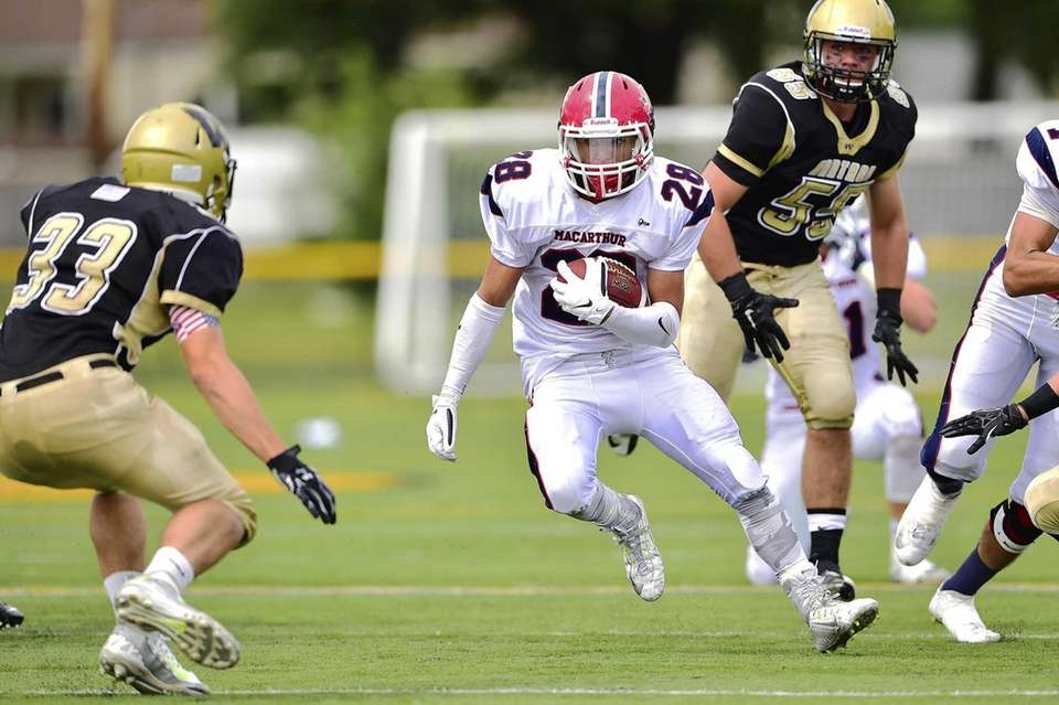 MacArthur running back Vin Martino (28) runs for