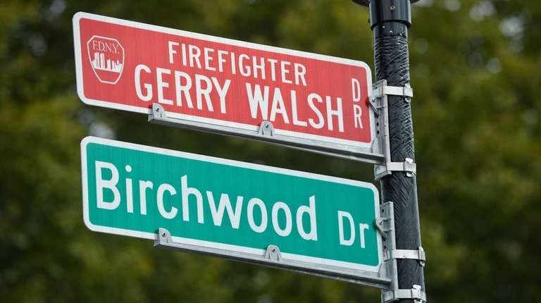 The newly placed street sign in Westbury honors