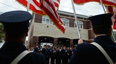 Members of the Lindenhurst Fire Department listen as
