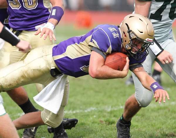 Sayville's Jack Coan keeps the ball and dives