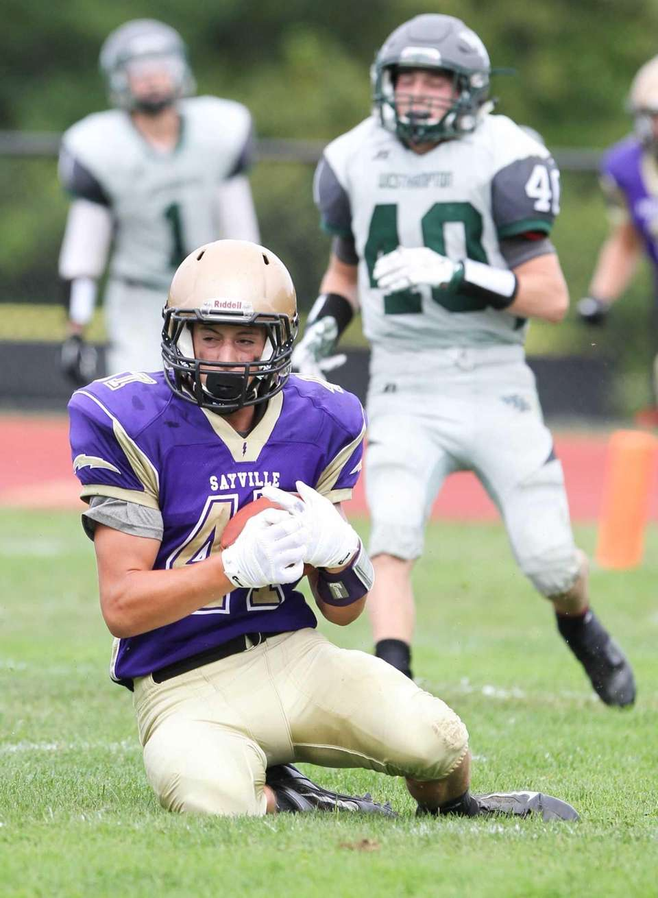 Sayville's Michael Dionisio catches a TD pass in