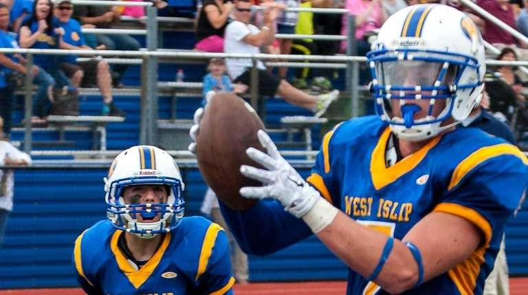 West Islip's James McCorvey scores a touchdown during
