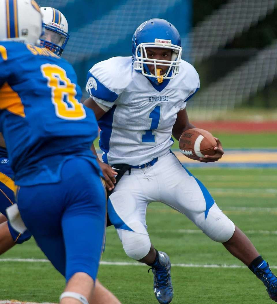 Riverhead's Sharron Trent carries the ball during a
