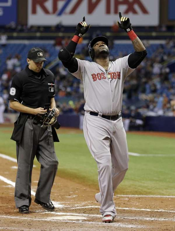 Boston Red Sox's David Ortiz reacts after hitting