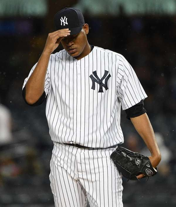 New York Yankees starting pitcher Ivan Nova reacts