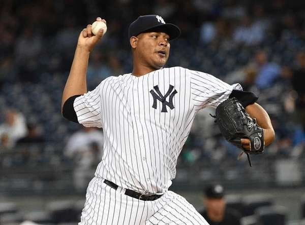 New York Yankees starting pitcher Ivan Nova delivers