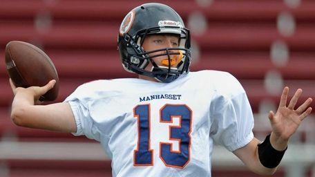 Manhasset quarterback Connor Barrett throws a pass during