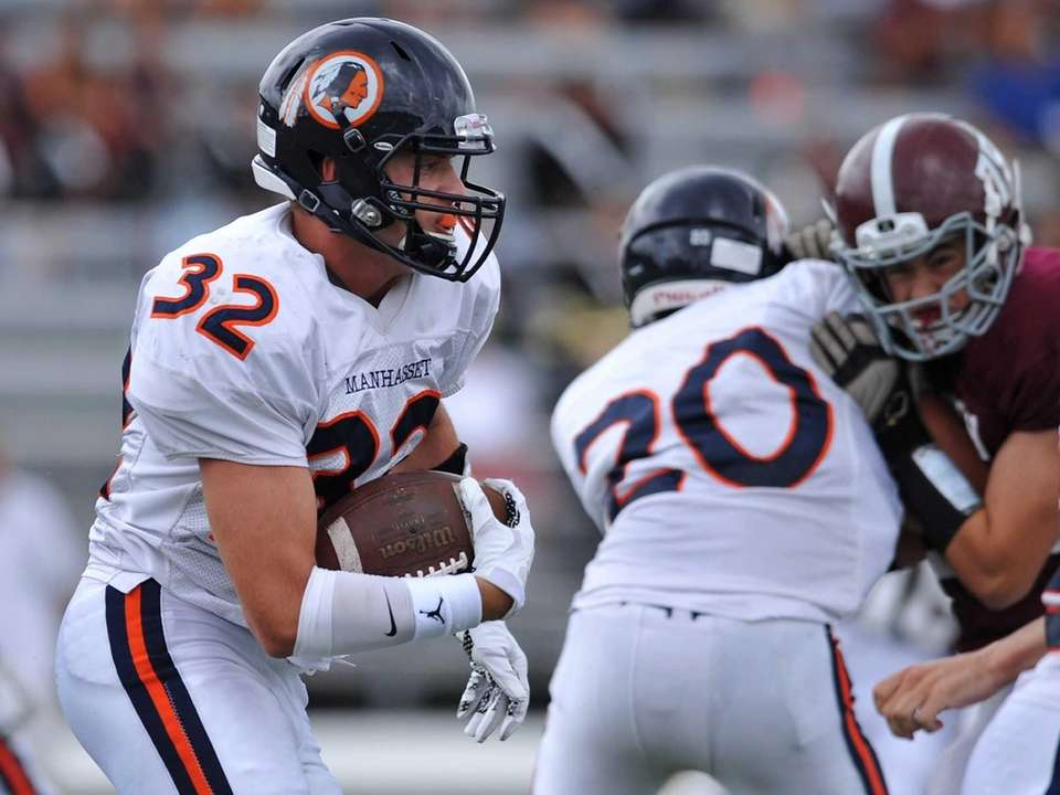 Manhasset's Will Theodoropoulos races upfield during a Nassau