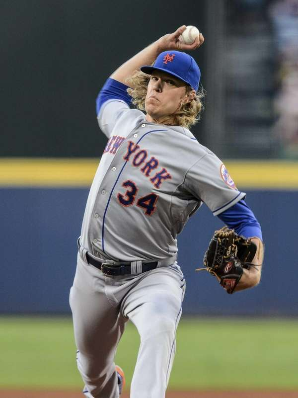 New York Mets starting pitcher Noah Syndergaard works