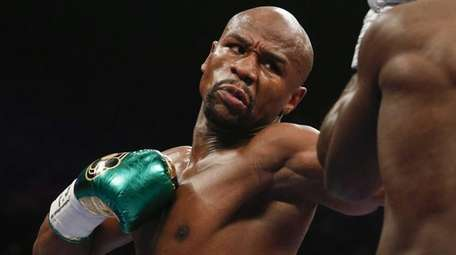 Floyd Mayweather Jr. hits Andre Berto during their