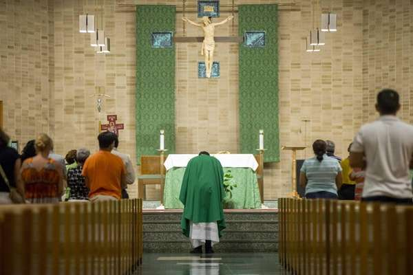 Parishoners in Brentwood pray on Sept. 10, 2015,
