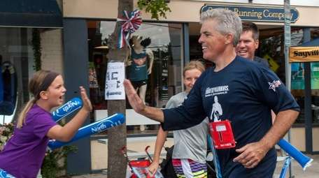 Suffolk County Executive Steve Bellone gets high-fives from