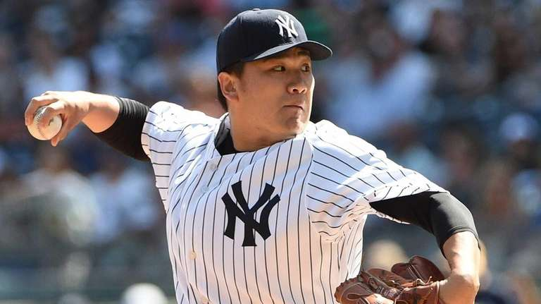 New York Yankees starting pitcher Masahiro Tanaka delivers