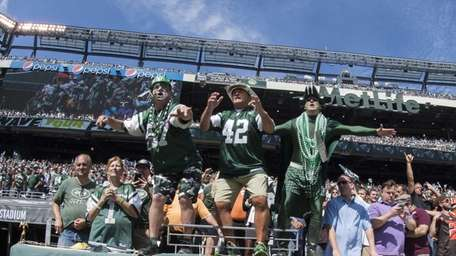 Jets fans pump up the crowd before a