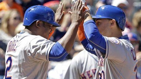 The New York Mets' Michael Conforto celebrates with