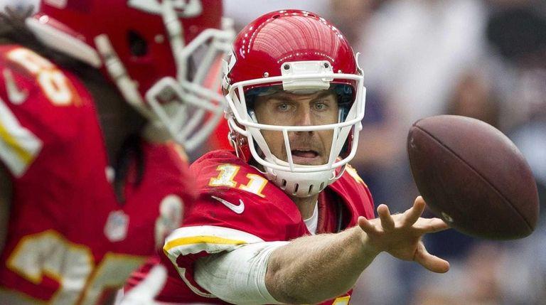Kansas City Chiefs quarterback Alex Smith tosses the