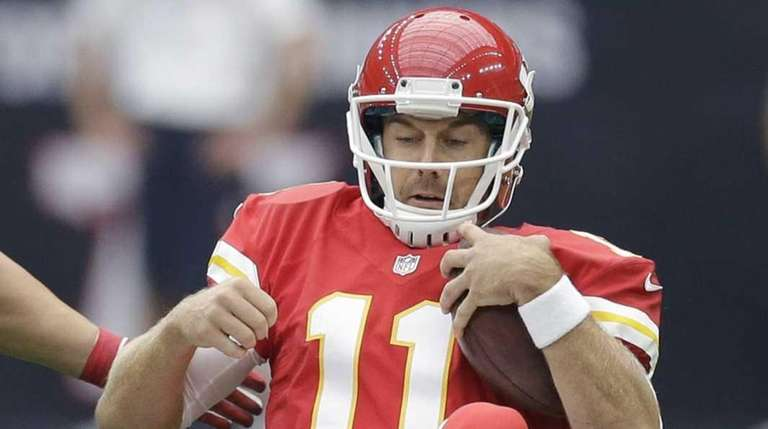 Kansas City Chiefs' Alex Smith (11) is stopped