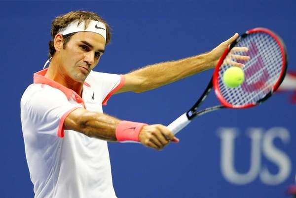 Roger Federer returns a shot to Stan Wawrinka