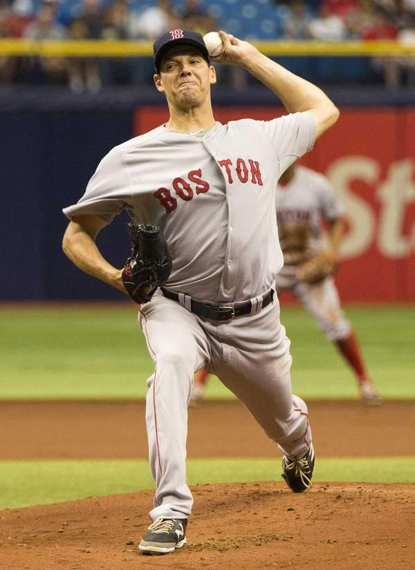 Boston Red Sox relief pitcher Rich Hill delivers