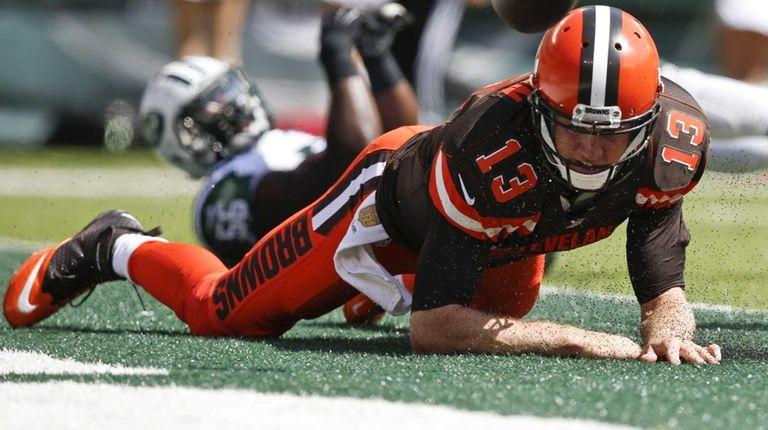 Cleveland Browns quarterback Josh McCown (13) fumbles the