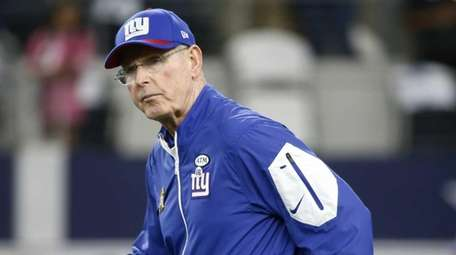 New York Giants head coach Tom Coughlin takes