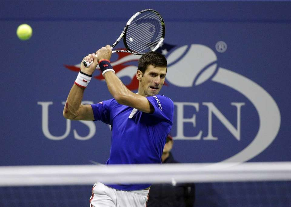 Novak Djokovic, of Serbia, returns a shot to