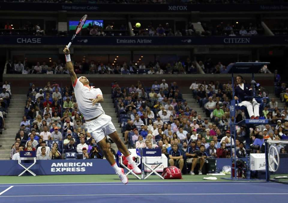 Roger Federer, of Switzerland, returns a shot to