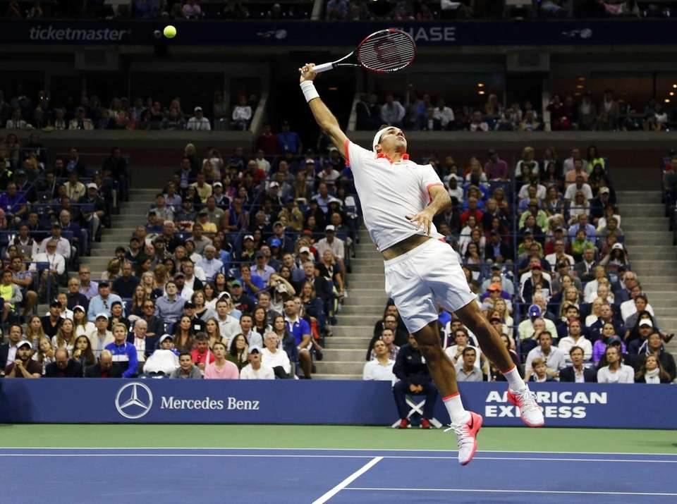 Roger Federer, of Switzerland, can't make the play